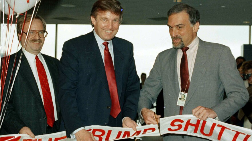 Back when commercial lenders were eager to do business with him, Donald Trump briefly operated an airline. In this 1989 picture, Trump attends a ribbon-cutting for the venture at Boston's Logan International Airport.