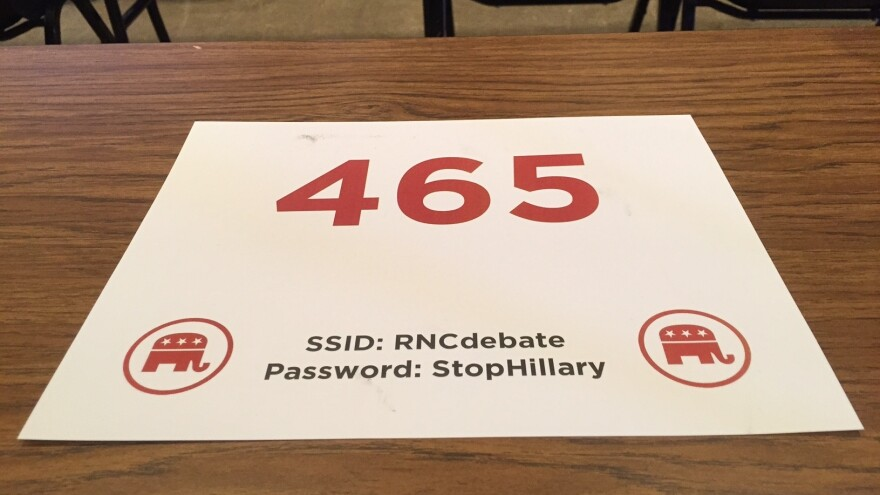 "A card on a desk at the GOP presidential debate in Milwaukee, Wis., Tuesday, noting the password to access Internet in the media filing center — ""StopHillary."""