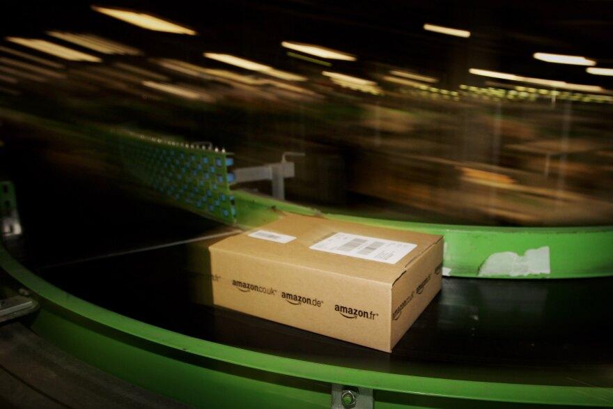 An Amazon.co.uk parcel passes along a conveyor belt at a facility in Milton Keynes, England.