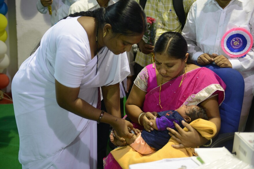 A nurse in Hyderabad, India, gives a vaccine to a child. The immunization will protect against diphtheria, pertussis, tetanus and other diseases.
