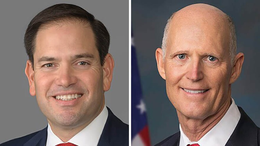 U.S. Sens. Marco Rubio, left, and Rick Scott.