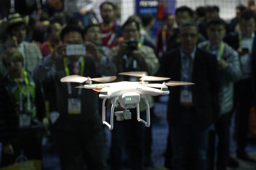 A drone hovers at the DJI booth during CES International in Las Vegas. (John Locher, File/AP)