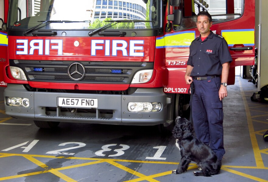 London firefighter Paul Osborne with his service dog, Sherlock.