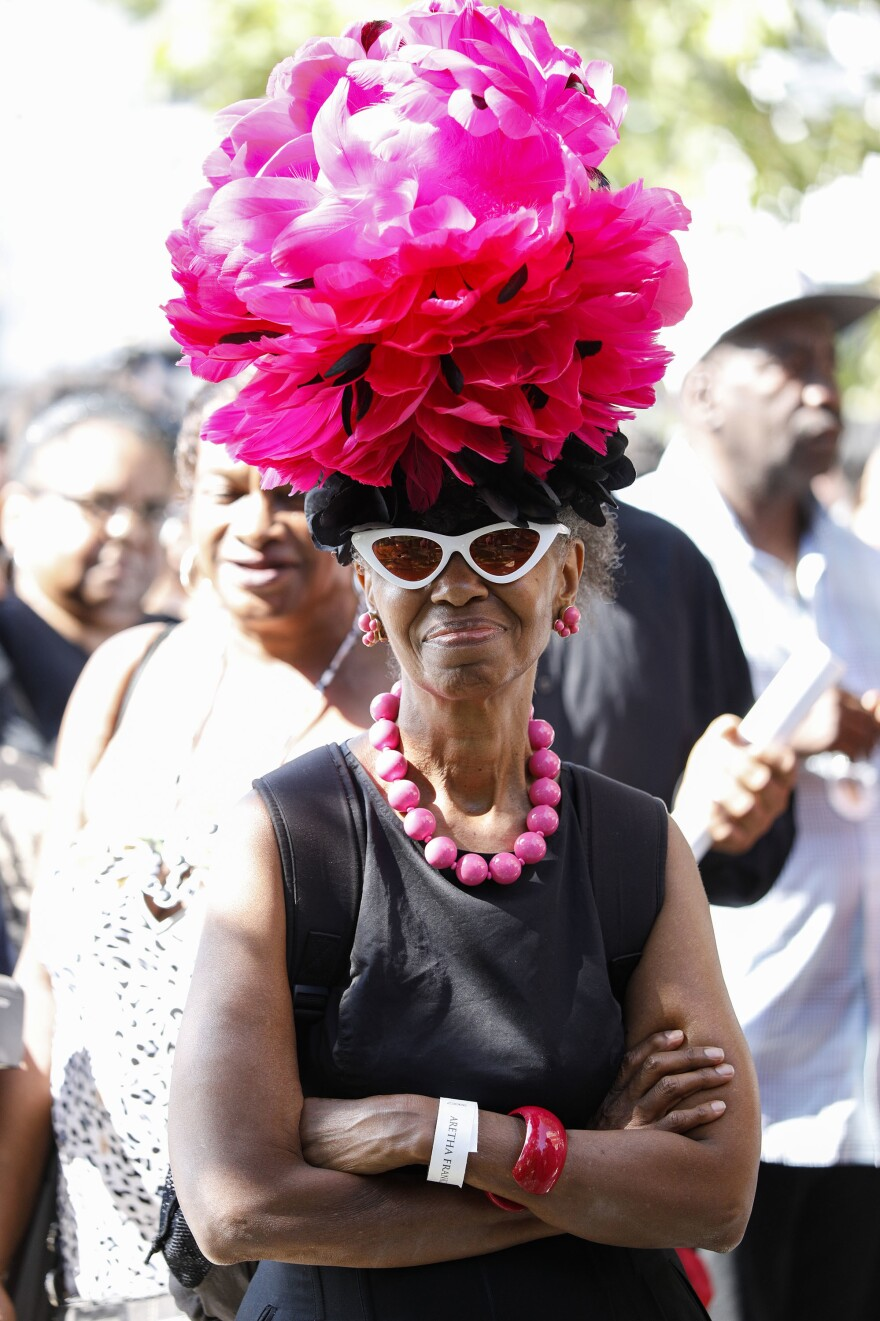 Fans of soul music icon Aretha Franklin line up outside Detroit's Greater Grace Temple for the singer's homegoing celebration.