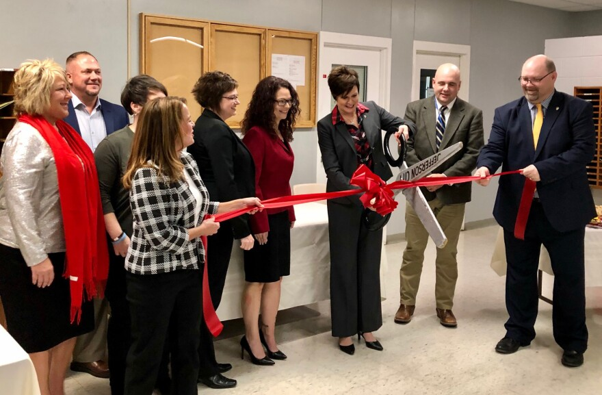 DOC director Anne Precythe, center, cut the ribbon on the Tipton Re-Entry Center during an official ceremony on December 13, 2019.