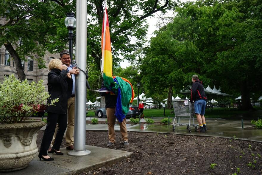 Photo of flag raising.