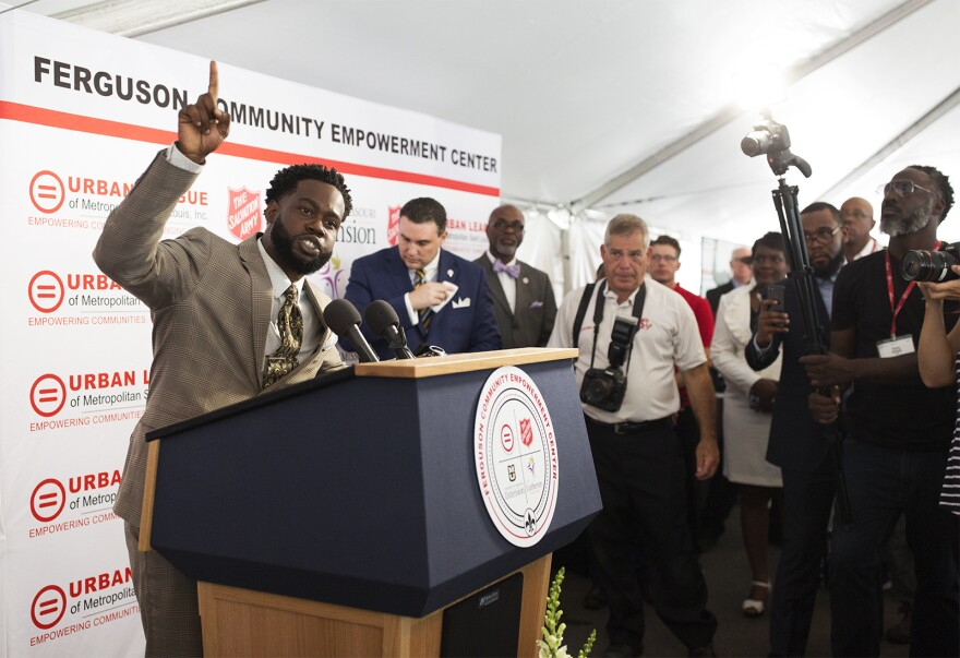 Willard Donlow, a graduate of the Save our Sons program, addresses the crowd at the opening of the Ferguson Community Empowerment Center. July 26, 2017.