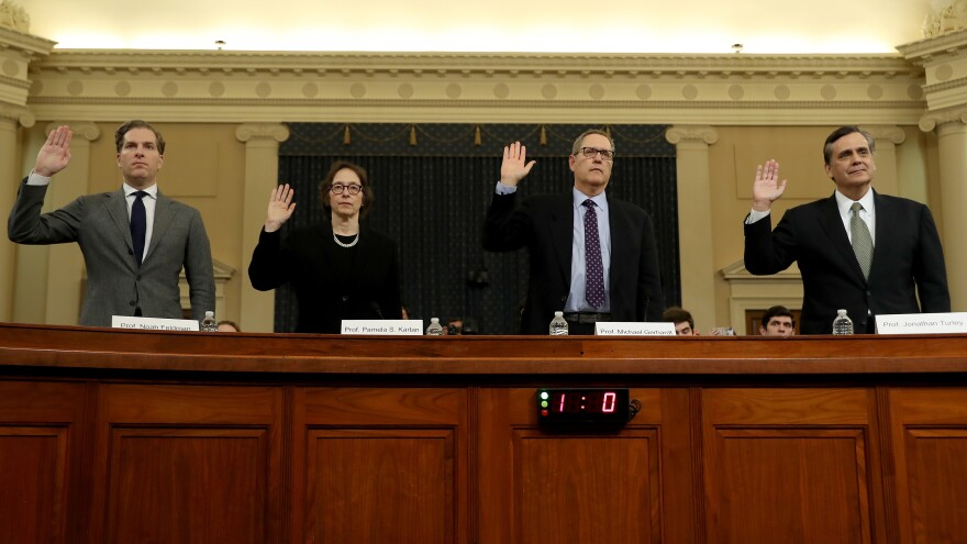 Constitutional scholars Noah Feldman (from left), Pamela Karlan, Michael Gerhardt and Jonathan Turley are sworn in to testify before the House Judiciary Committee Wednesday.