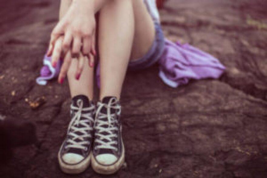woman-shoes-hands-300x200.jpeg