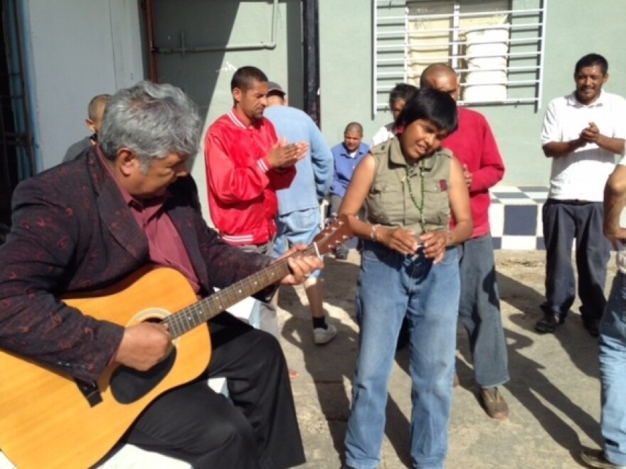 Pastor Jose Antonio Galvan, who founded the Vision en Accion asylum, plays guitar and sings with residents.