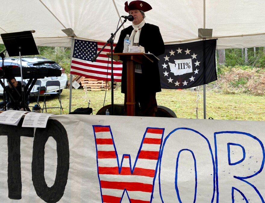 A man in Revolutionary War-era costume speaks to the crowd at the Freedom To Worship Protest in Whidbey Island, WA, on October 18, 2020.