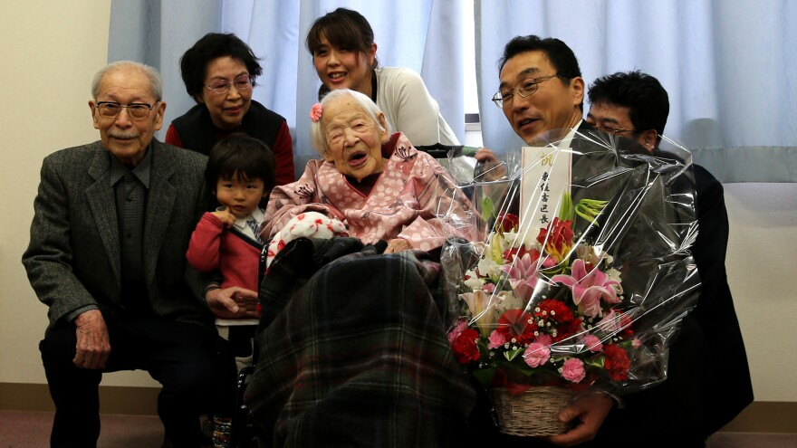 Misao Okawa, who died at age 117, posed for a photo with her son Hiroshi Okawa, 92, (left) and other family members as they celebrated her birthday last month in Osaka, Japan.