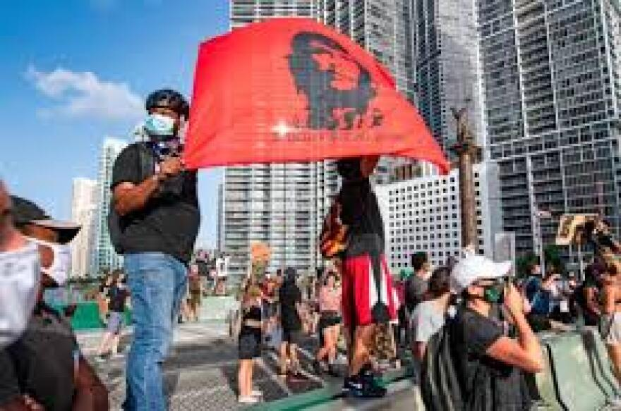 Racial justice protesters in Miami unfurl a Che Guevara banner this year.