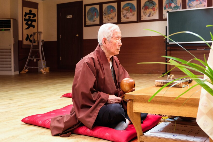 The Korean War veteran chants Buddhist sutras in his prayer hall to console the spirits of fallen fellow child soldiers.