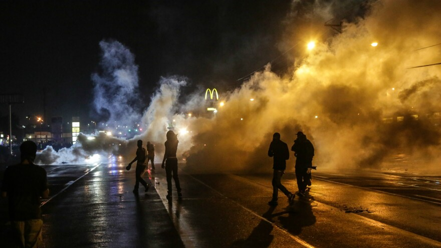 Protesting youth were stranded on the street after curfew when Missouri Gov. Jay Nixon declared a state of emergency and imposed a midnight-to-5 a.m. curfew in Ferguson in August 2014.