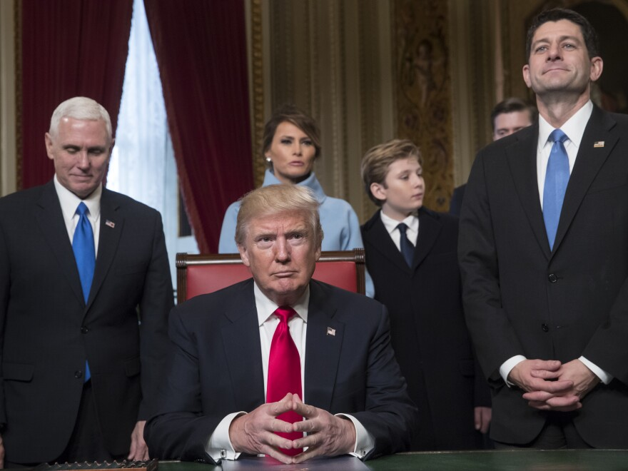 President Donald Trump is joined by the Congressional leadership and his family before formally signing his cabinet nominations into law on Jan. 20 in the President's Room of the Senate on Capitol Hill in Washington. From left are, Vice President Mike Pence, the president's wife Melania Trump, their son Barron Trump, and House Speaker Paul Ryan.