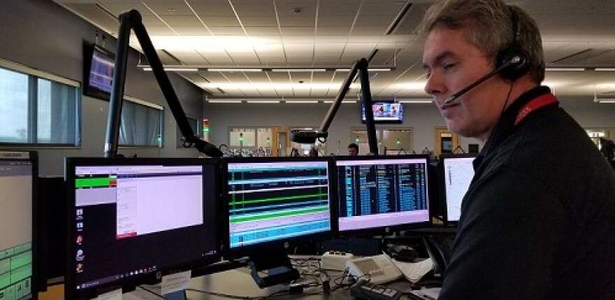 Will Blanton has been an emergency dispatcher for nearly 27 years. He spends long shifts at his treadmill-equipped desk at the CDA.