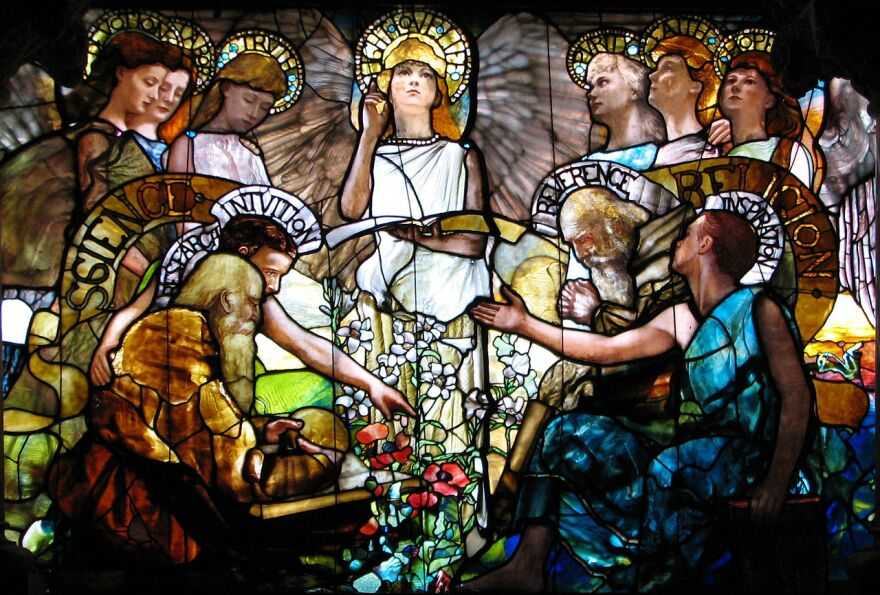 """Dr. Ed Hogan of the St. Louis Archdiocese said he believes there is a """"false"""" contradiction between faith-based and scientific beliefs, a theme similarly depicted in this Tiffany stained glass window located at Yale University."""