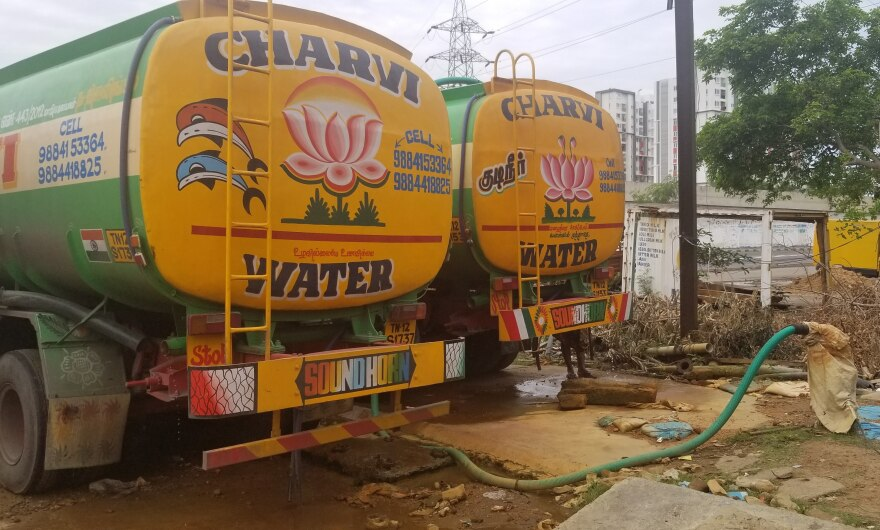 Private water tanker trucks fill up at a bore well on Chennai's outskirts. The area was once a lush farming village but has become part of Chennai's expanding urban periphery. Locals are drilling bore wells to sell their groundwater. It's more profitable than using the water to irrigate crops.