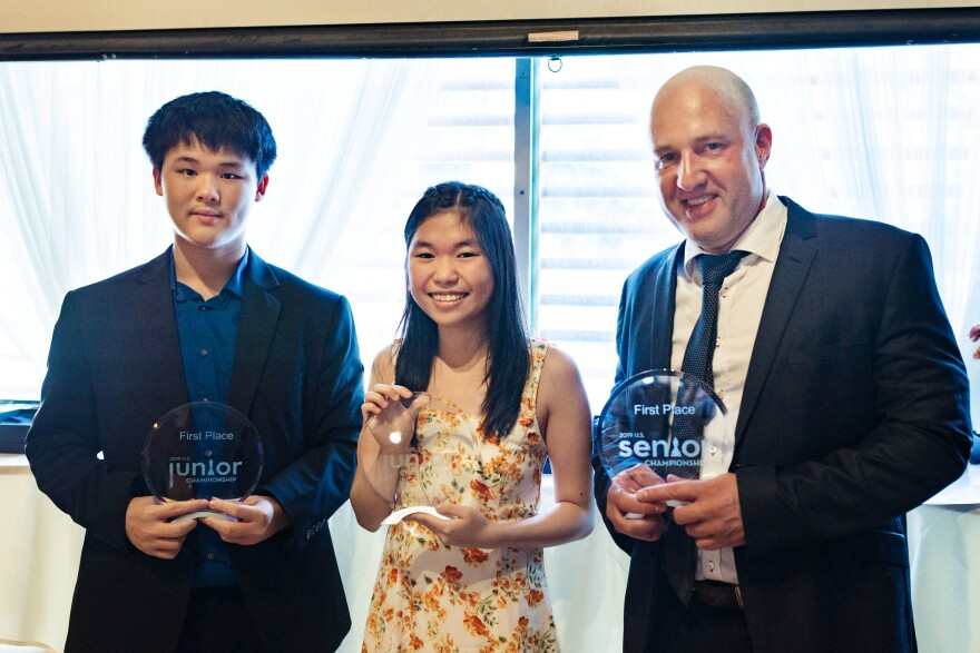 Awonder Liang (left), Carissa Yip (middle) and Alex Shabalov (right) prevailed at the U.S. Chess Championship tournament in St. Louis in July 2019.