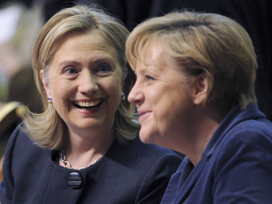 U.S. Secretary of State Hillary Rodham Clinton, left, smiles as she talks with German Chancellor Angela Merkel at the start of the OSCE Summit at the Palace of Independence in Astana, Kazakhstan in December.