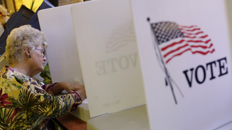 A voter fills out her ballot during early voting before the 2012 presidential election at the Gila County Recorder's Office in Globe, Ariz., on Oct. 26.
