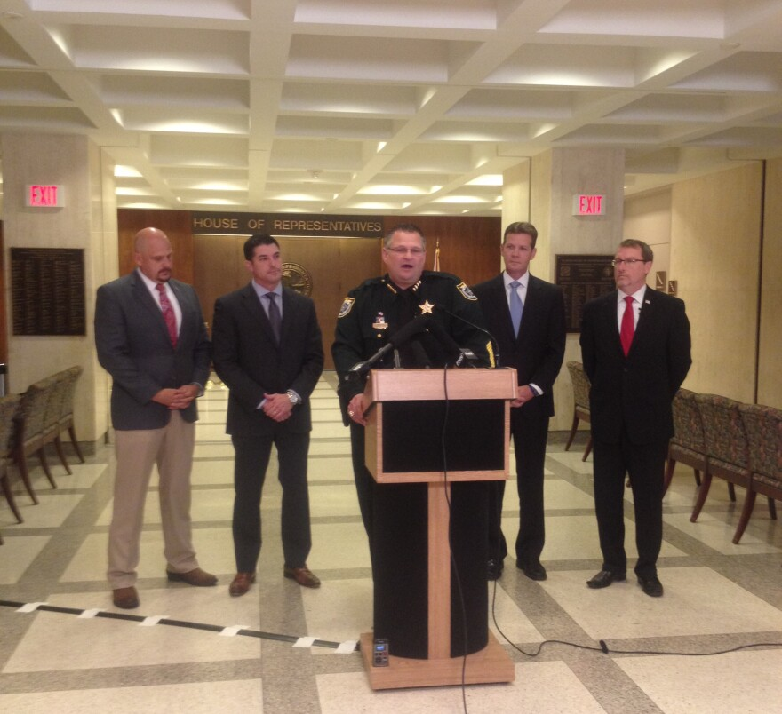 Brevard County Sheriff Wayne Ivey speaking during a press conference about a pilot parenting program. He's joined by (left to right) Rep. Ritch Workman, House Speaker Steve Crisafulli, Sen. President Andy Gardiner, and Brevard State Attorney Phil Archer.