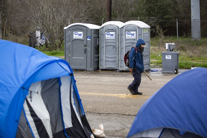 Most of the residents of Camp R.A.T.T. live in tents pitched on asphalt.