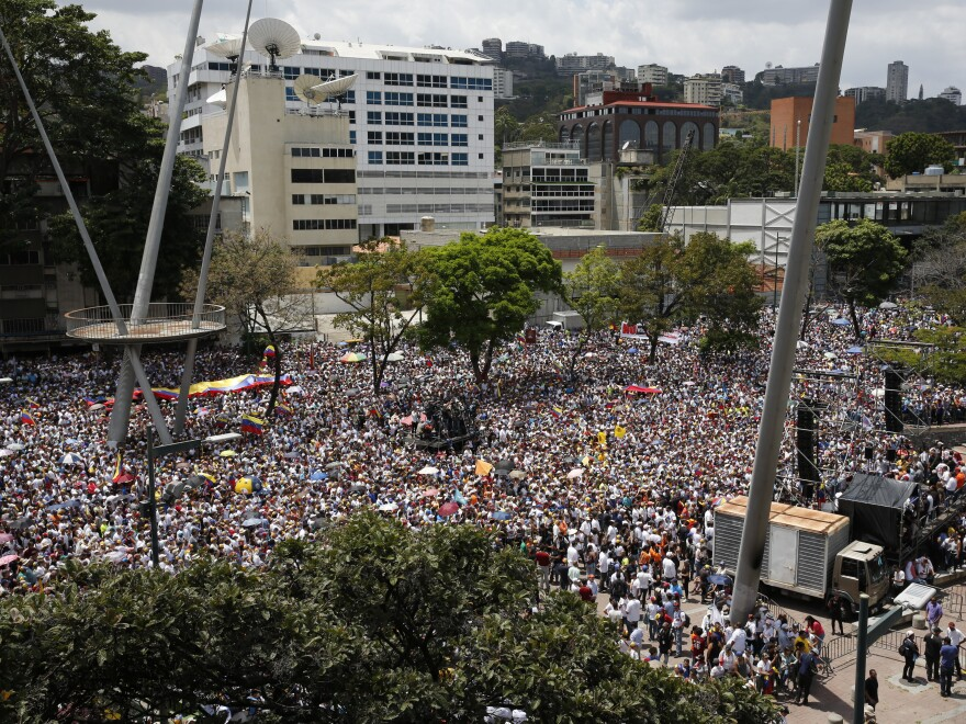 Anti-government protesters rally to demand the resignation of Venezuelan President Nicolas Maduro in Caracas on Monday, the same day opposition leader Juan Guaidó returned to the country.