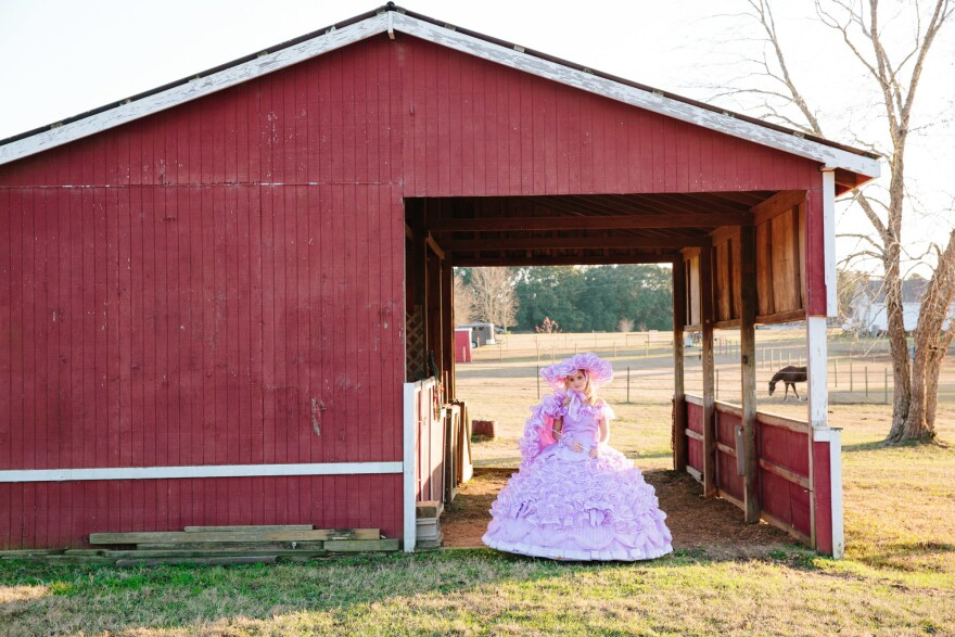Courtney Glenn poses in her lavender Trail Maid dress at her home just outside of town.