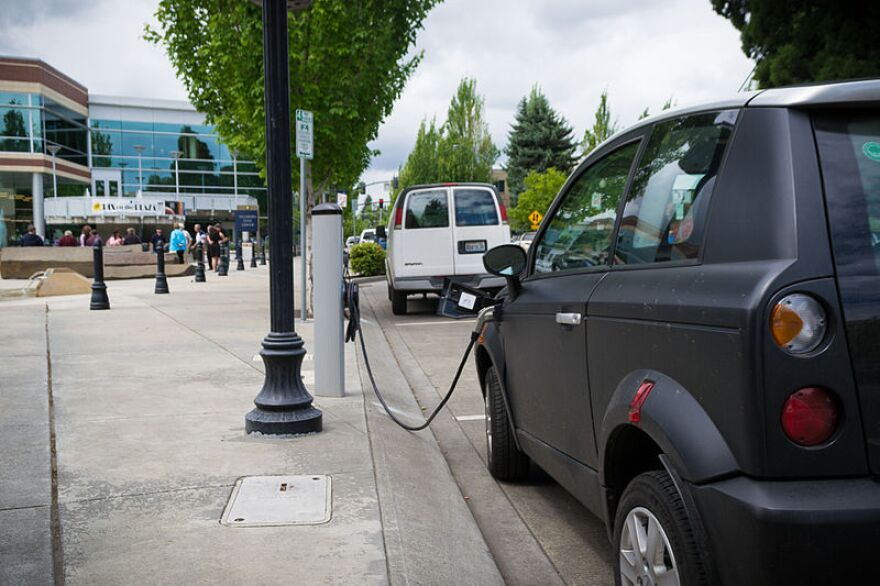 An electric car being charged at a station in Hillsboro, Oregon.