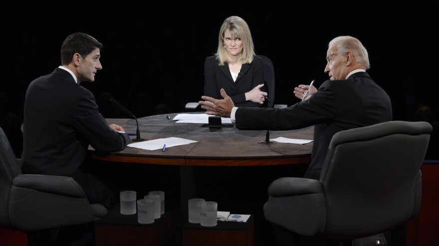 Vice President Joe Biden speaks as Republican Rep. Paul Ryan and moderator Martha Raddatz listen during the vice presidential debate at Centre College on Thursday in Danville, Ky.