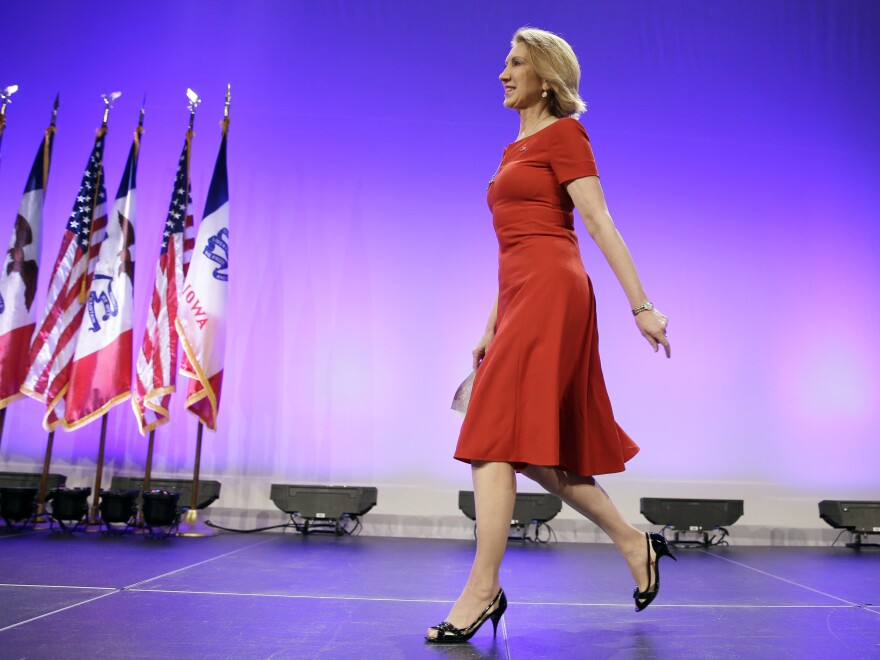 Republican presidential candidate Carly Fiorina walks onstage to speak during the Iowa Republican Party's Lincoln Dinner.