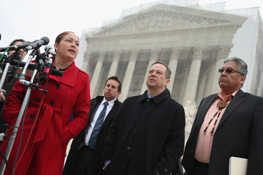 Mexican American Legal Defense and Education Fund Director of Litigation Nina Perales (from left), MALDEF lawyer Luis Figueroa, Georgetown University law professor Jon Greenbaum and San Carlos Apache Tribal Chairman Terry Rambler talk with reporters outside the U.S. Supreme Court after attending oral arguments in <em>Arizona v. Inter Tribal Council et al</em>. in March.