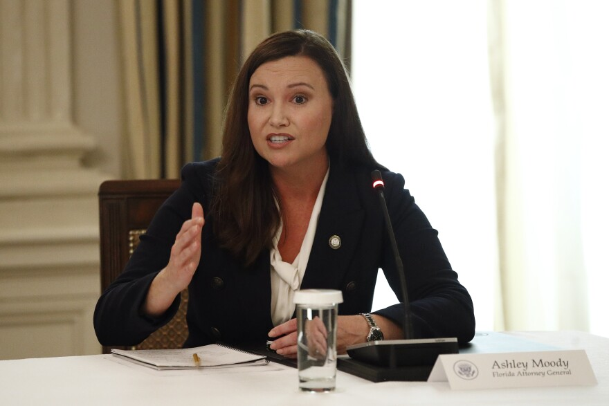 Florida Attorney General Ashley Moody speaks during a roundtable discussion with President Donald Trump and law enforcement officials, Monday, June 8, 2020, at the White House in Washington. (AP Photo/Patrick Semansky)