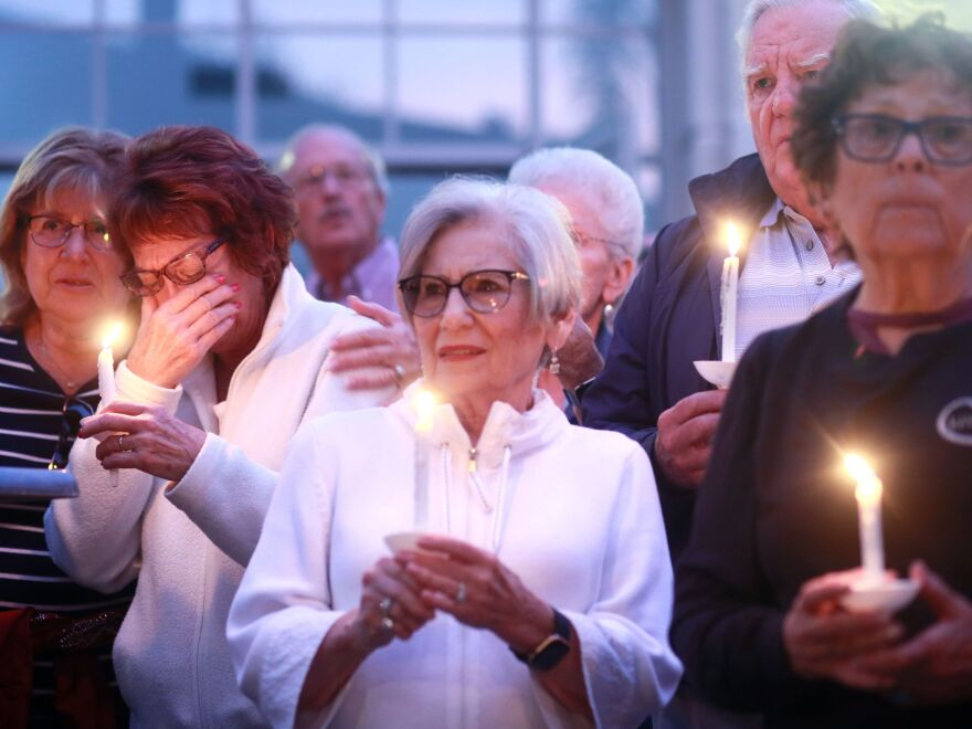 Mourners participate in a candle light vigil for the victims of the Chabad of Poway Synagogue shooting at the Rancho Bernardo Community Presbyterian Church on April 27, 2019 in Poway, Calif.