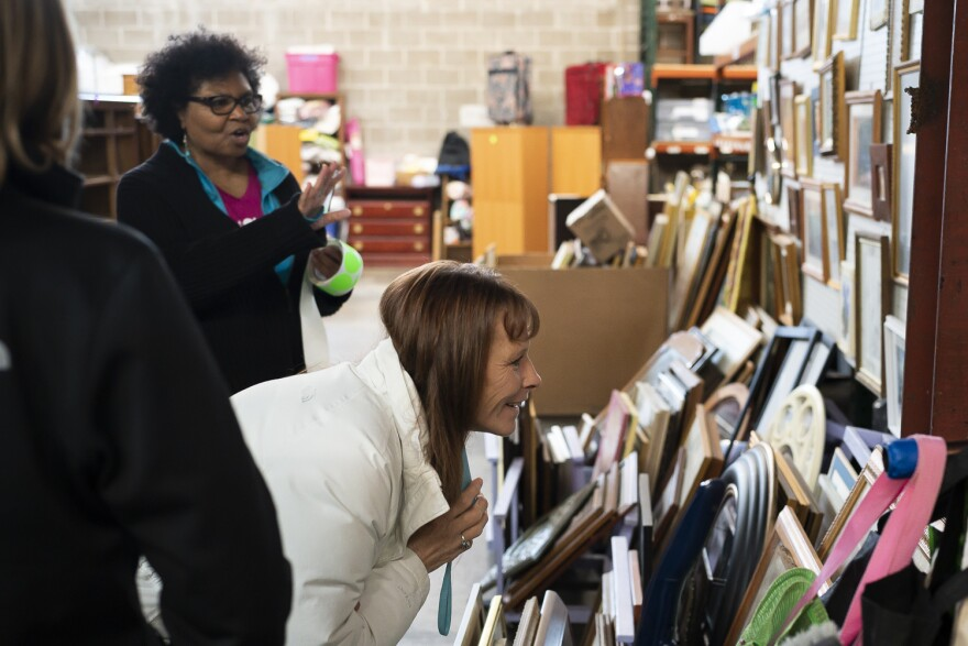 Home Sweet Home volunteer Joyce Givens (left) shows Mary Hayes a display of picture frames, mirrors and other wall hangings on Feb. 27, 2019