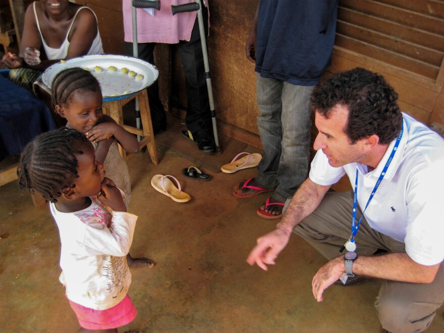 Paul Spiegel meets children displaced by conflict in Ivory Coast in 2011.