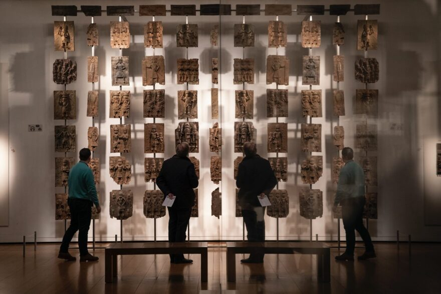 Plaques that form part of the Benin Bronzes are displayed at The British Museum in London. The Bronzes were stolen from the African country of Benin by British troops in 1897.