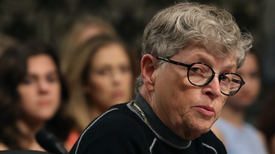 Lou Anna Simon, former president of Michigan State University, testifies during a Senate Commerce, Science and Transportation Committee hearing in June.