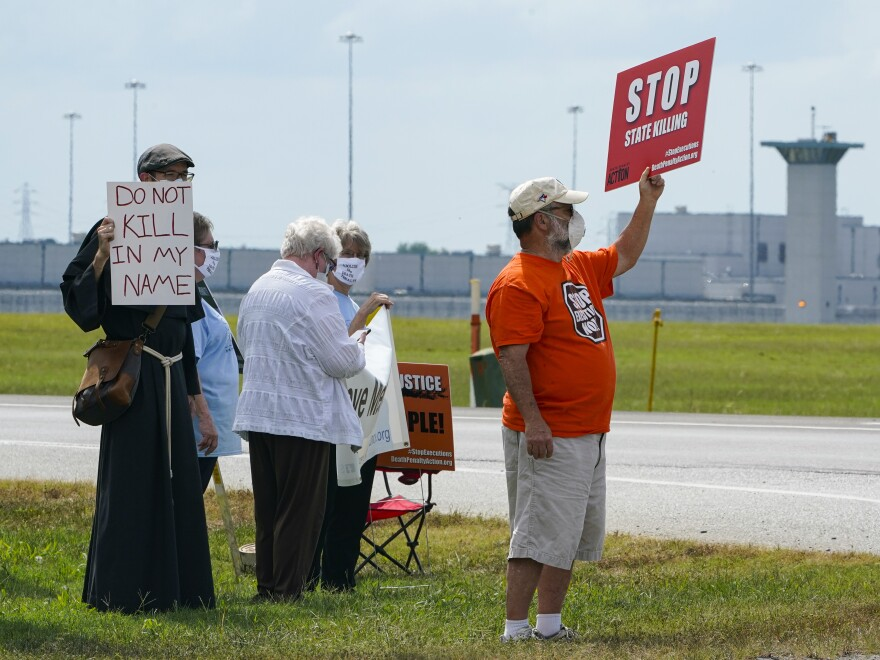 Demonstrators gathered across from the federal prison complex in Terre Haute, Ind., to protest the death penalty. Another execution is scheduled for Thursday.