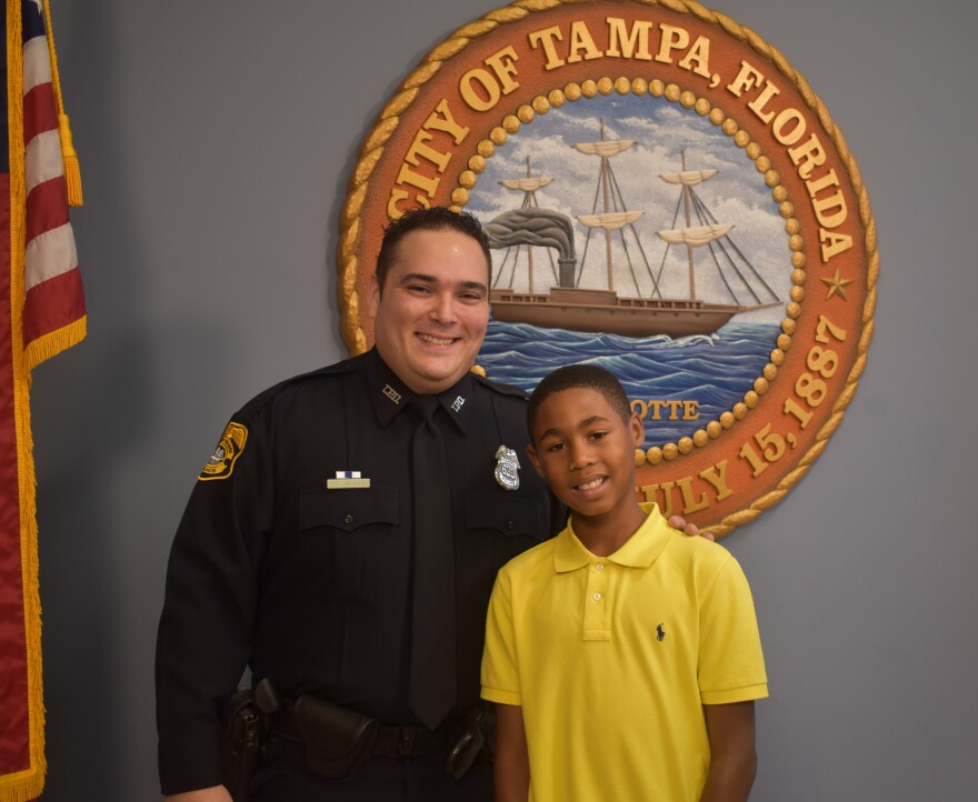 Tampa Police officer Joel McKee and Princeton, 10, are paired together in the Big Brothers Big Sisters' Big's in Blue program, which pairs children with law enforcement. MANELLE KHEIREDDINE, WUSF PUBLIC MEDIA