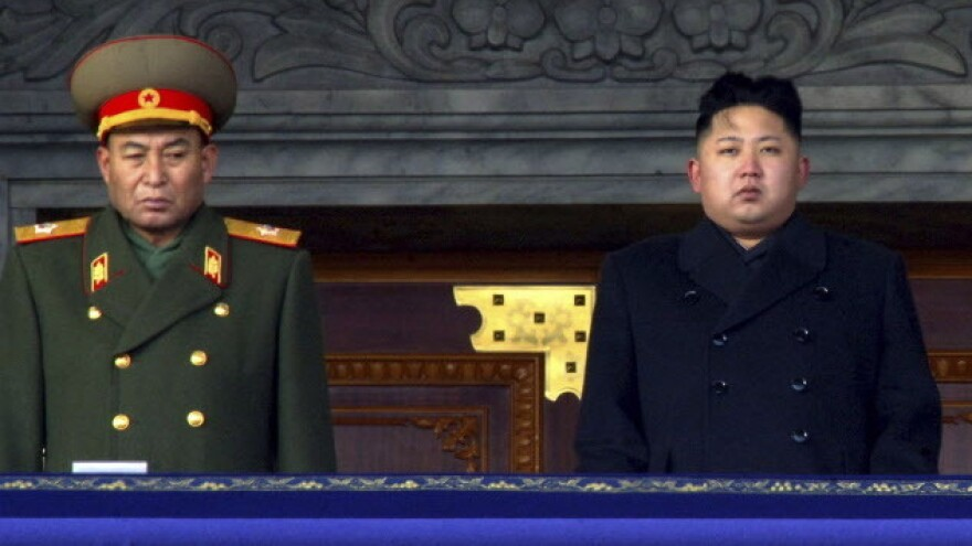 Dec. 29, 2011: new North Korean leader Kim Jong Un, right, and Vice Marshal Ri Yong Ho at a national memorial service for Kim's father, Kim Jong Il. Reports from North Korea say the military leader has been removed from his post.