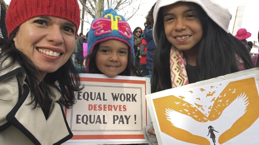 A federal court has sided with Aileen Rizo, who filed suit after realizing her male counterparts were being paid more. The ruling overrules a previous interpretation of the 1963 Equal Pay Act. Rizo is seen here with her daughters in a photo she provided to the AP in 2017.
