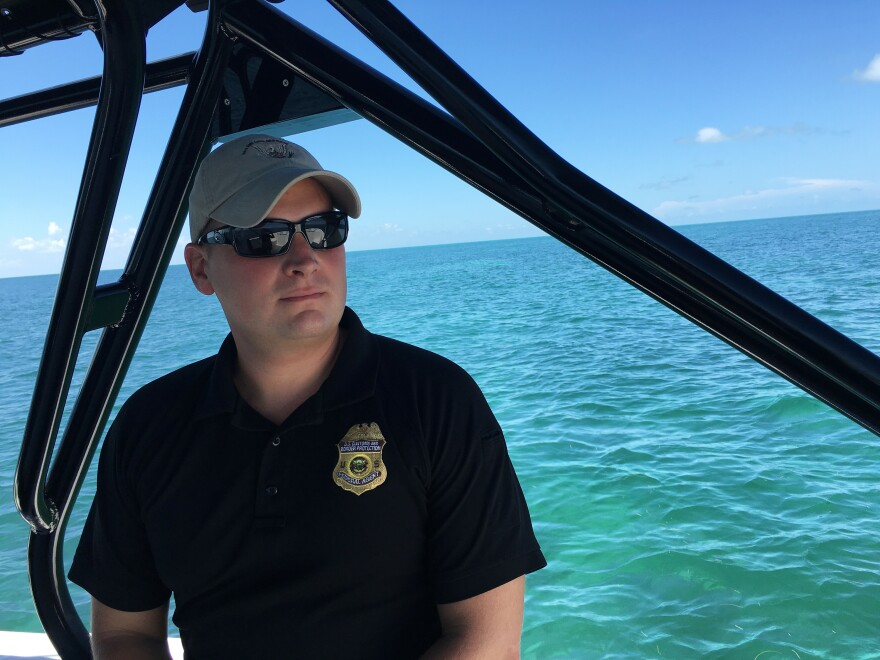 """John Apollony is a marine interdiction agent with U.S. Customs and Border Protection. """"They don't want us coming near them, and they're gonna do everything to get their vessel to shore,"""" he says of the Cuban migrants."""