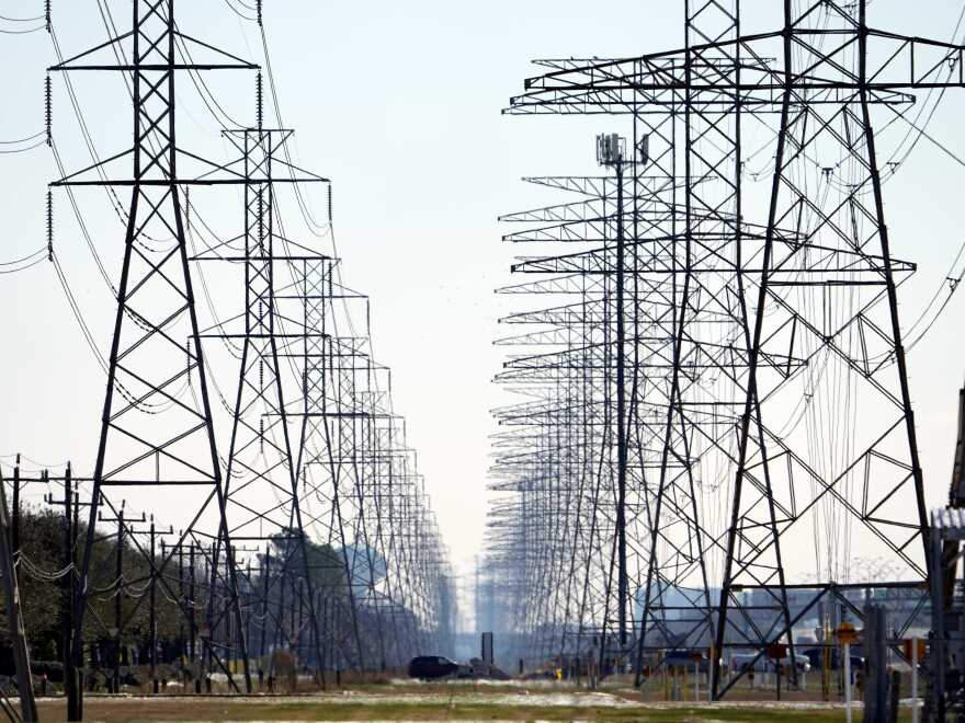 Power lines near Houston on Feb. 16, 2021. Some residents of Texas are facing enormous power bills after wholesale prices for electricity skyrocketed amid a massive grid failure.