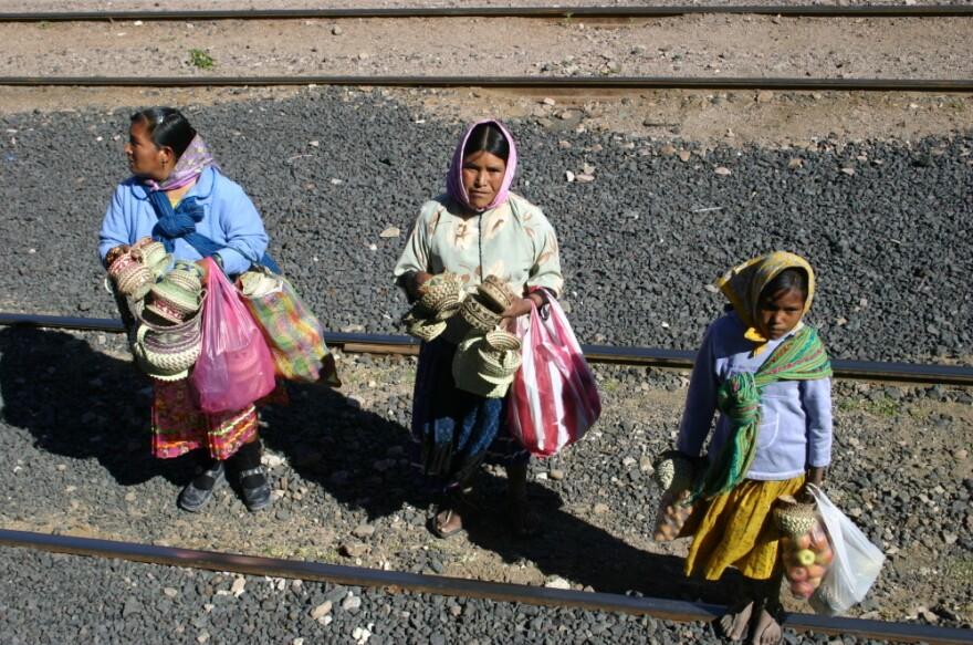 In this photo taken on Nov. 9, 2011, Tarahumara women are seen peddling goods to passengers of El Chepe, a government-run train.