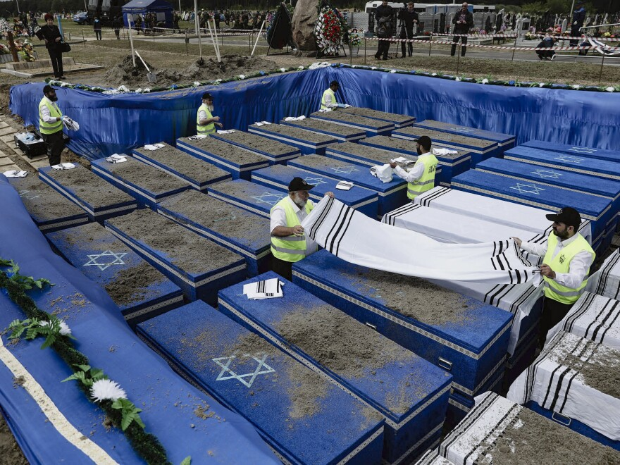 Volunteers bury the remains of more than 1,000 Holocaust victims at a cemetery just outside Brest, Belarus, on Wednesday.