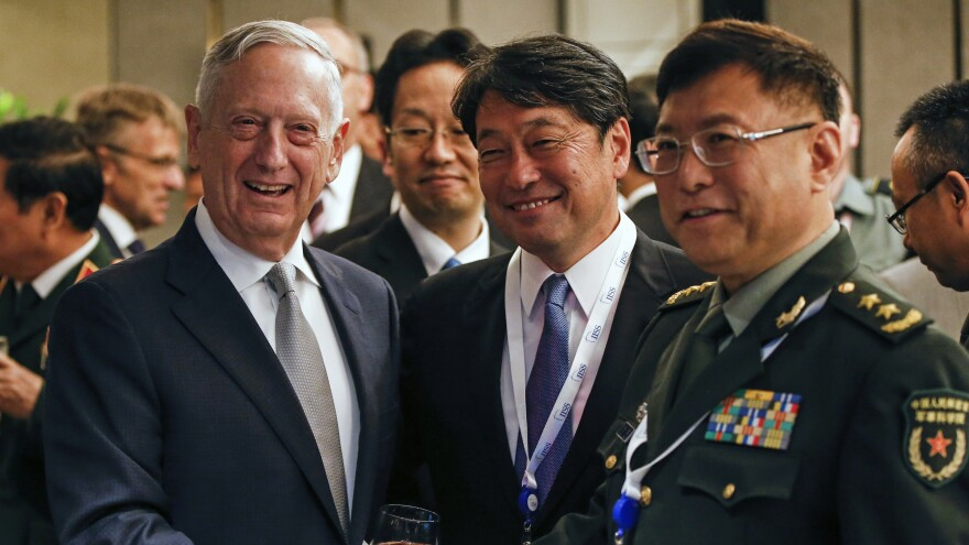 From left, U.S. Defense Secretary Jim Mattis, Japan's Defense Minister Itsunori Onodera and China's People's Liberation Army's Academy of Military Science Deputy President He Lei pose for photos at a ministerial roundtable on the sidelines of the 17th International Institute for Strategic Studies (IISS) Shangri-la Dialogue.