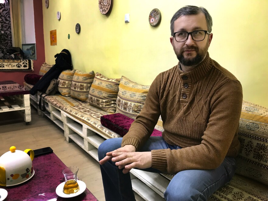 Nariman Dzhelyal, a Crimean Tatar leader, in a cafe in Crimea's capital Simferopol last month. He has remained in Crimea despite pressure from the Russian authorities.